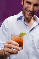 Man drinking a cocktail