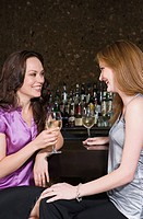 Two women drinking in a bar