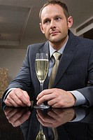 Man drinking champagne in a bar