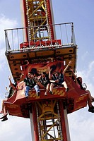 Teenagers on amusement park ride