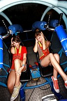Two female teenagers on amusement park ride