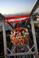 Teenagers on Ferris wheel in amusement park