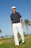 portrait of mature golf player wearing flat cap