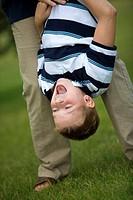 Boy hanging upside down