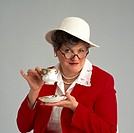 A woman having tea