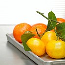 Tangerines on tray, close-up