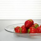 Strawberries on plate, close-up