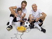 German soccer fans, playing video game, portrait