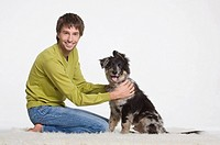 Young man with dog, portrait