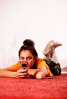 Woman, young, seriously, cell phone, SMS, receives, reading, lie, floor, people, girl, 16-20 years, 20-30 years, brunette, braid, lace-up-boots, tailo...