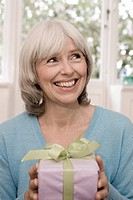 Senior, gift, holding, cheerfully, portrait series people, seniors, woman, grey-haired, birthday, packet, gets, surprise expectation curiosity anticip...