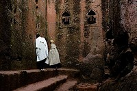Two monks in a church, Golgotha Church, Lalibela, Ethiopia