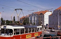Tram moving on a road, Red Electric Tram, Prague, Czech Republic
