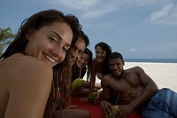 Multi-ethnic friends at beach