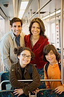 Hispanic family on train