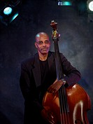 African man holding upright bass