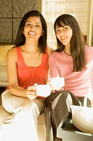 Multi-ethnic women drinking coffee