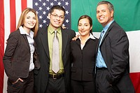 Group of Hispanic businesspeople hugging