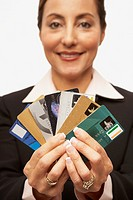 Hispanic businesswoman holding credit cards