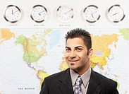 Indian businessman in front of global map