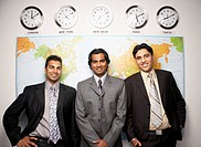 Indian businessmen in front of global map