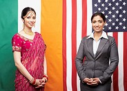 Indian businesswomen in front of flags