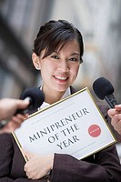 Woman with Minipreneur of the Year Award