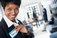Businesswoman Putting on Her Name Tag