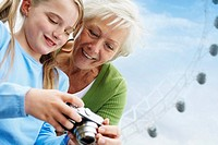 Grandmother and Granddaughter with Digital Camera