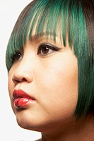 Close up of Asian woman with lip piercing
