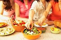 Multi-ethnic female friends eating