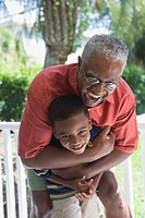 African American grandfather hugging grandson