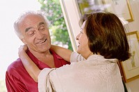 Senior Hispanic couple smiling at each other