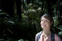 Asian woman in woods
