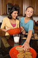 Multi-ethnic girls baking cookies