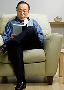 Senior Asian man reading book