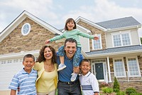 Hispanic family in front of house (thumbnail)