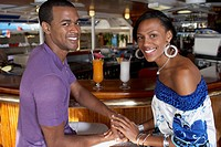 Multi-ethnic couple at bar