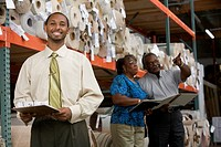 African American sales representative in carpet warehouse
