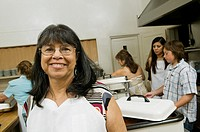 Hispanic woman wearing apron