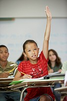 Asian girl raising hand in class