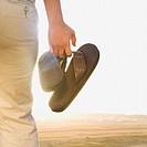 Close up of Hispanic woman holding shoes