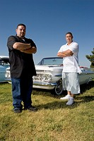 Hispanic men in front of low rider car