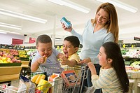 Hispanic mother and children in grocery store