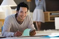 Asian businessman working on floor