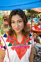 Hispanic woman wearing colorful shirt