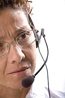 A portrait of a woman with a headset on
