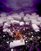 A man drowning in a sea of medication