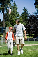 Father and son walking together