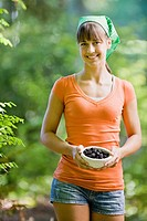 Teen girl with bowl of berries